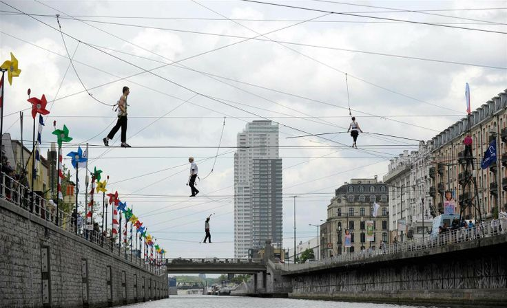 Tightrope Walkers Cross Canal in Brussels (Photo: Laurent Dubrule / Reuters)