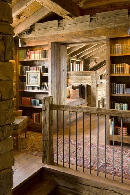 Alpenstrasse - wooden cabin with books at the top of the stairs and what looks to be a bed or reading nook behind