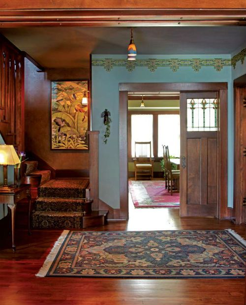Hand-painted geometric frieze in the front hall of a Prairie house, based  on a vintage design. Photo: Scott Van Dyke - looks like every wall in my  daughters ...