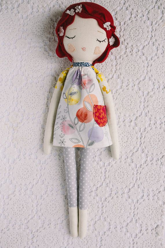 This red haired Blossom Doll is made using cottons and vintage fabrics and her hair is made of bright red pure wool felt. She is between 17-18 inches tall and wears a removable vintage style dress with pattern pocket. Her dress is fully removable but the patterned fabric that makes up her sleeves and legs are not removable.  This doll is handmade by me in my studio in Warwickshire, England. She is not factory perfect but instead, perfectly imperfect! She is not suitable for children under 3…