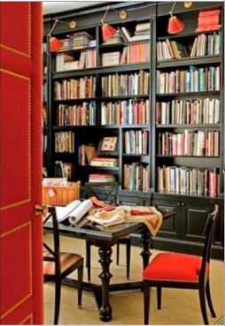 Suzanne Rheinstein  upholstered door and red library lights.