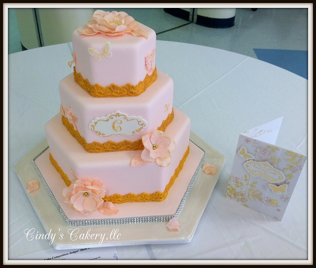 Cindy's Cakery // Pink and Gold hexagon wedding cake with monogram plaque // www.cindyscakery.com