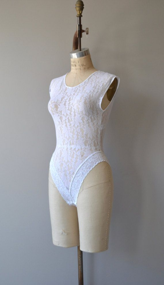 Vintage 1980s white sheer lace bodysuit with high cut lace leg and deep scoop back. ✂-----Measurements  fits like: small bust: up to 38 waist: up to 32 hip: up to 36 length: 24 brand/maker: n/a condition: excellent  to ensure a good fit, please read the sizing guide: http://www.etsy.com/shop/DearGolden/policy  ✩ more lingerie | swim ✩ https://www.etsy.com/shop/DearGolden?ref=hdr_shop_menu&section_id=7337122  ✩ visit the shop...