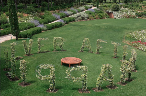 For the Harmony ('L'Armonia') of Ornellaia 2007, Ghada Amer has creating the site-specific installation garden, where the letters compose the phrase Happily*Ever*After, reminiscent of a fairy tales' happy ending.