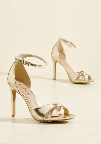 Shape up for a dazzling night by stepping into a sassy ensemble and buckling into these shiny gold stilettos! With their crisscrossing toe straps and fab faux leather filling you with confidence, you exude an unmistakable fierceness that draws all the right kind of attention.