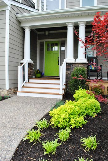 Homearama: Green Front Door; I love brightly painted front doors! And the lime green plants help tie it all together. Lovely!