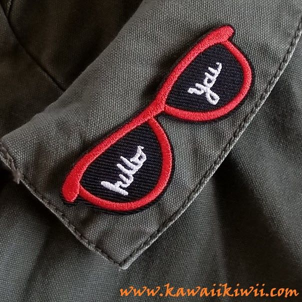 """""""Hello You"""" red & black sunglasses iron on patch from Kawaii Kiwii.  Flirty and cool, show off your bold personality! Strategically add this to your collar and you need not say more ;) Iron on patches, badges, pins from anime, sci-fi, fantasy, TV series, movies and more. From www.kawaiikiwii.com"""