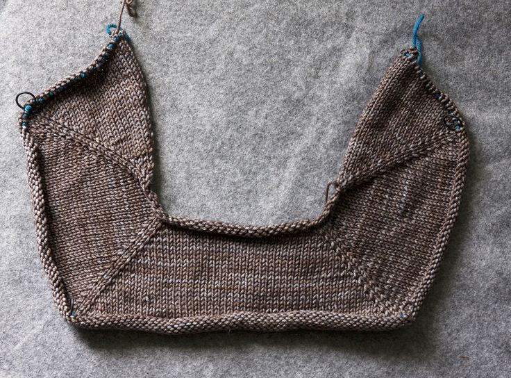 I've placed the completed yoke stitches on waste yarn to show the shape created by the raglan increses