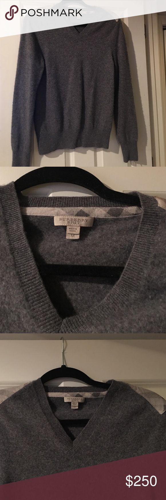 Burberry Men's Cashmere Sweater! This is a Burberry men's v-neck cashmere sweater! This has the signature print on the shoulders! Very good condition, there is a small hole (pictured above in the right armpit) it is not noticeable however, and could be easily fixed! Paid $800 for this sweater new several years ago! Burberry Sweaters V-Necks