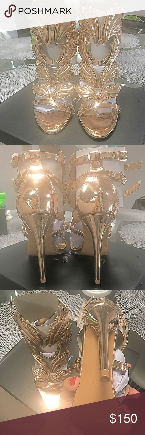 New Gold Wing Heels Are these not gorgeous!!! Only reason I am selling was because I purchased another color pair in a smaller size & I lost receipt and was unable to return these.These are a size 6.5 (I purchased a 6 because I wanted them snug). The 6.5 gives you a little wiggle room so I can say they fit a true 6.5 & a 7 if you want them just right. Free free to ask questions! I may be able to wiggle the price just a tad nothing major. If these don't sell I may just end up wearing these…