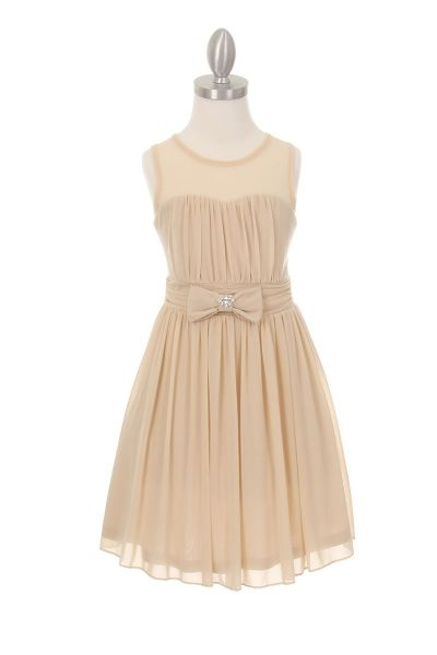 Chiffon Sweetheart Girls Dress in Champagne BeigeThis pretty little beige dress is a beautifully blend of neutral colors and tones. This style is perfect with any of the new seasons blush or garden tones. This style is fully lined with a soft satin lining. The sweetheart neck line is an adorable contrast and created the entire look of this dress.