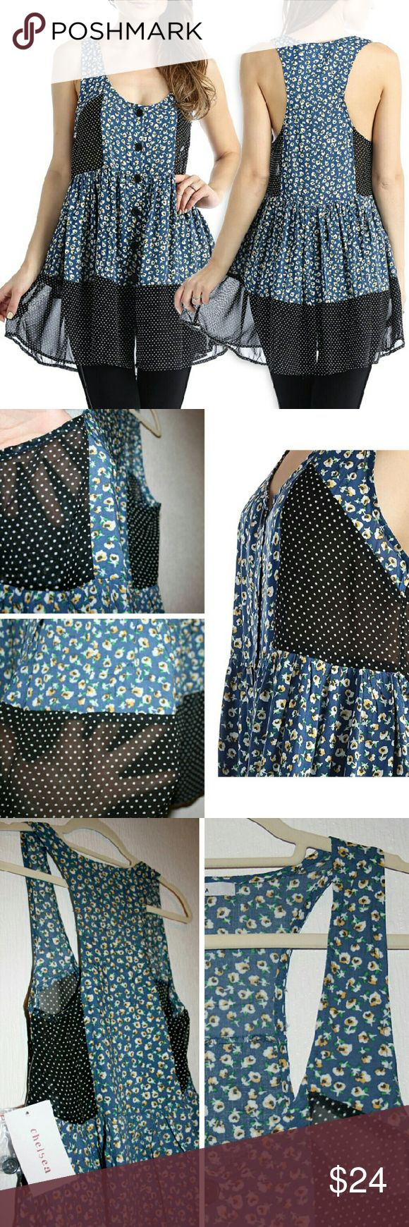 Floral & Polka Dot Buttoned Racerback Tunic NWT I am pretty sure this is the most adorable tunic ever! I mean, it's so cute I can't stand it! :D It features black & white polka dot panels on the sides and bottom, while the body is a sweet yellow & white flower print on blue. The polka dot fabric is definitely sheer while the floral print body is just really lightweight. I also love that it has cute buttons up the front (and a spare). The shell is 100% polyester, and the contrast is 100%…