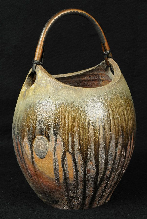 "Reiko Cohen  |  ""Vase12a"".  Wood-fired ceramic w/ rattan handle (8""w x 7.5""d x 13.5""h)."