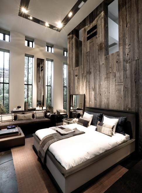 Classy And Modern Bedroom With Wood Wall Panels.
