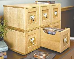 """DVD Case Plan - Build a DVD storage case"" -- ""Versatile plan design lets you stack the drawers horizontally (photo left) or stack them vertically so they'll look like an old library card catalog (see closer look)."" Click through to purchase or see the other photo."