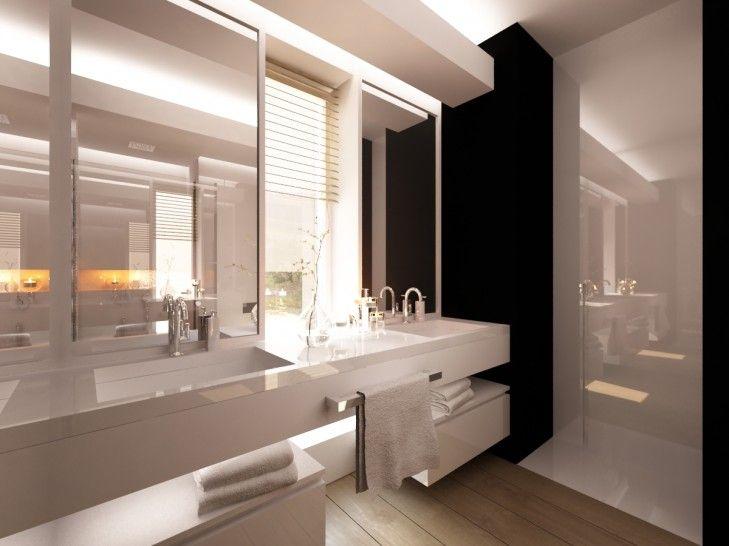 Projekt wnętrza biało- czarnej łazienki w domu pod Warszawą. Pomieszczenie zaprojektowano w kontrastowych biało czarnych barwach dodając na podłodze gres imitujący drewno dla ocieplenia.