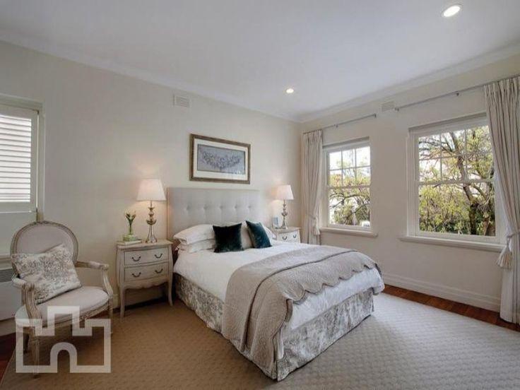 Classic bedroom design idea with carpet & sash windows using beige colours - Bedroom photo 268158