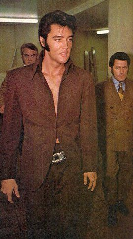 Elvis, brown and bare chested.  On his way to see Barbara Streisand in Las Vegas on July 28, 1969