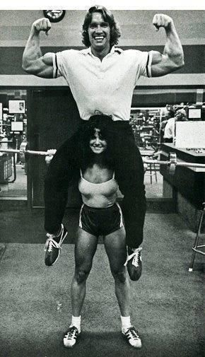 Arnold Schwarzenegger on a girls shoulders  1972
