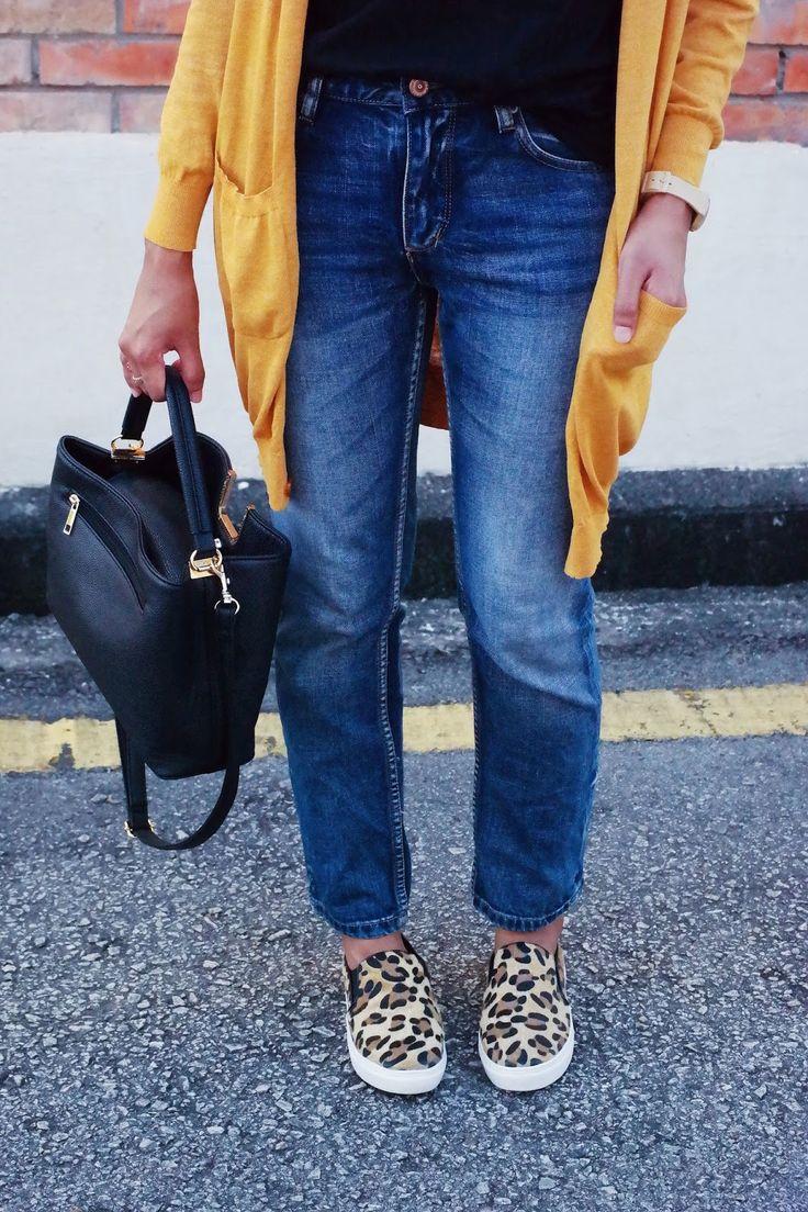 Blue straight jeans, mustard cardigan, leopard print slip-ons