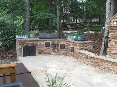 outdoor kitchen with big green egg and another smoker