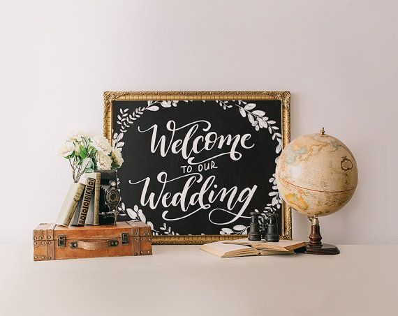 Welcome your guests to the wedding in style with this gorgeous hand lettered sign featuring a chalkboard background and soft floral…