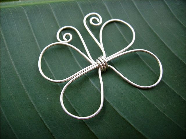 wire butterfly - would be cute with some beads wrapped into the wings! (or finer wires used as veins in the wings)