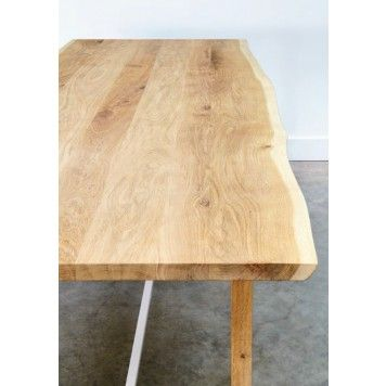 SQUEEZE TABLE by Universo Positivo. The raw surface of the Squeeze table captures each piece's story, giving it subtle yet unique character.