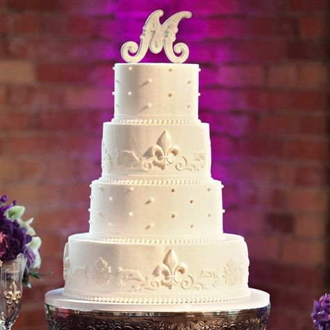 White with Swiss dots and scrolling fleur-de-lis...the initial must go...and be replaced with flowers perhaps....then perfection.
