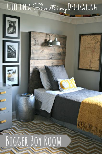 "Great Guy's Room with an industrial/ rustic feel (mustard and gray color scheme): walls - ""Passive"" by Sherwin Williams, outdoor light from Lowe's over bed, wood plank headboard, map art, hammered metal garden stool for nightstand, Ikea Alina gray quilt with mustard throw blanket"