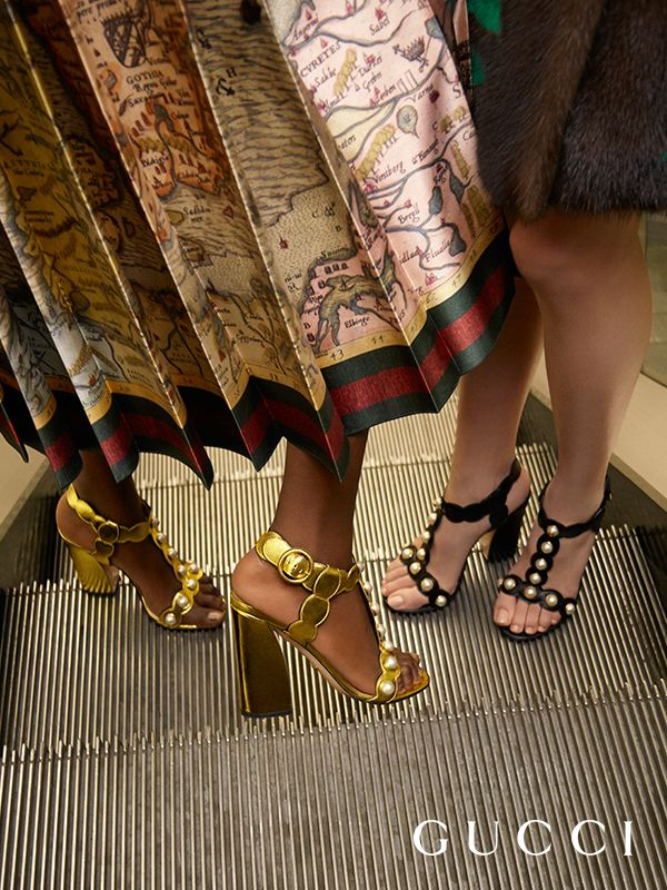 Presenting the new Willow t-strap sandals from Gucci Spring Summer 2016. In metallic gold or black leather, a curved heel, and embellished with GG pearls and studs.