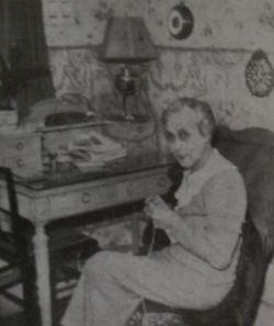"Jane Avril at home, aged 67, shortly before the ""Toulouse-Lautrec"" ball, 1935."