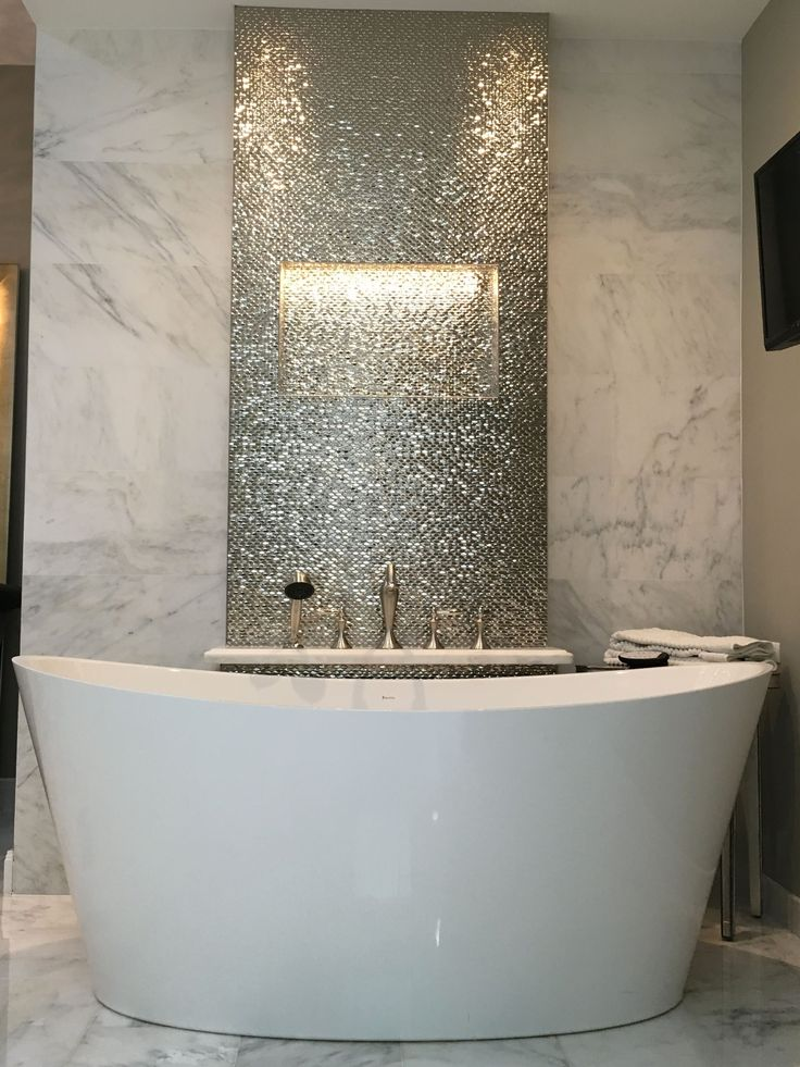 Freestanding tub with Porcelanosa Madison Plata wall tiles, First Snow Elegance…