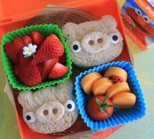 Angry Birds pigs with Bread; they could be made with a bear head cut out easily. / Cute Bento Box Sandwich Recipes.