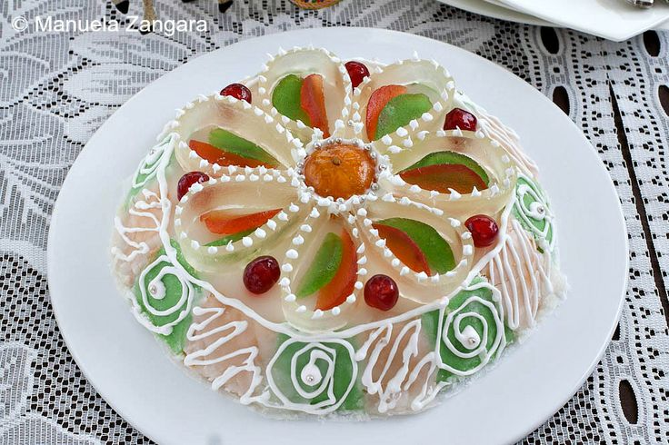 Cassata Siciliana ~  It is a delicious dessert made with sponge cake, filled with sweet ricotta and chocolate and decorated with candied fruits and royal icing.  Even though nowadays you can buy a cassata throughout the year, it is traditionally eaten at Easter.