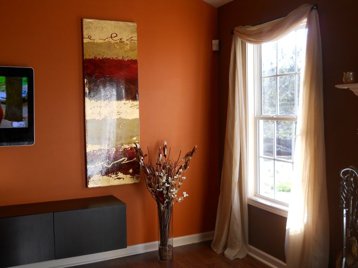 Living room chocolate brown walls with copper orange for Living room accent wall ideas