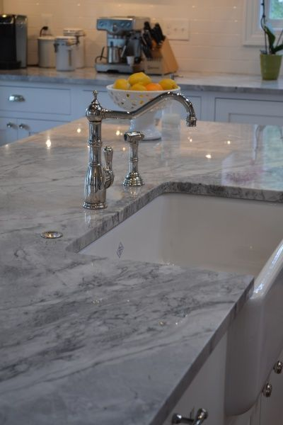 quartz is a clean and sturdy alternative to marble that is much easier to upkeep in your home.