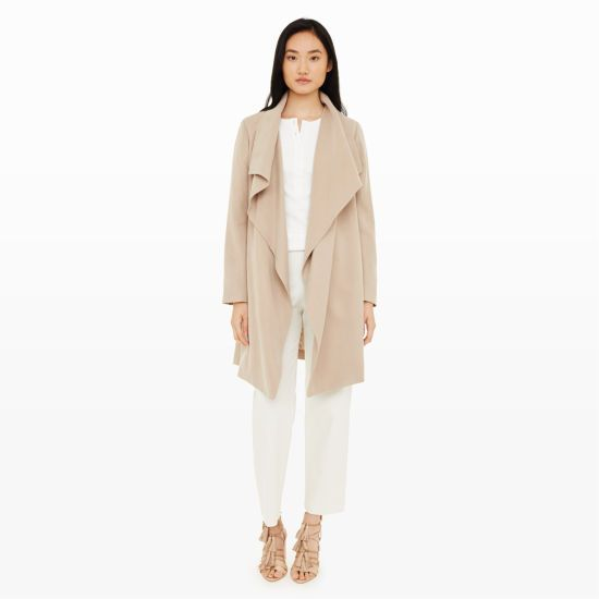 With just the right amount of slouch and soft structure, the luxe Martuska is this season's standout trench with its delectable drape. Its waterfall collar and belted waist add shape and dimension, lending an effortlessly polished feel that looks great over everything. Lyocell Slim fit Open draped front; hidden slit pockets at side seams; includes optional self-tie belt at waist Fully lined Dry clean Imported