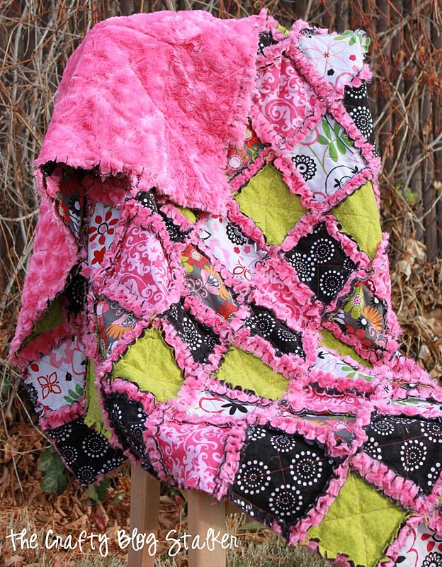 The Crafty Blog Stalker: Minky Rag Quilt.  I would make this using flannel for the colored squares instead of regular cotton.  Also, taping along the seams before cutting the minky will reduce the number of fibers floating away.