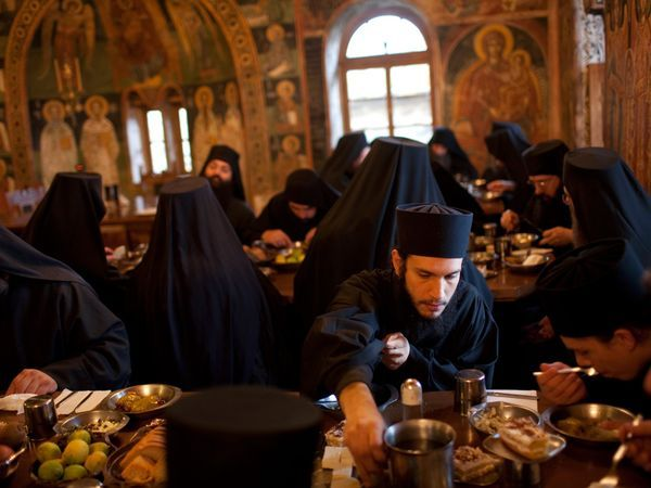 "Mount Athos Monastery  Photograph by Travis Dove  In the ancient monastic community of Mount Athos in northern Greece, Eastern Orthodox Christian monks live much as their brethren did a thousand years ago. A steady influx of young men over recent decades has actually increased their ranks. Mealtimes in the ornate refectory of the Xenofontos monastery, shown here, are a communal (though silent) affair.  From ""Called to the Holy Mountain"" in the December 2009 issue of National Geographic…"