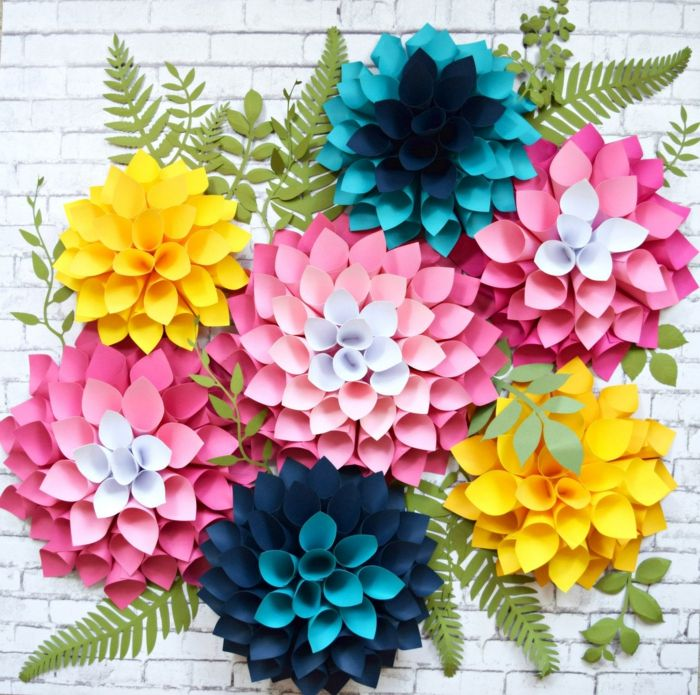 como hacer una rosa de papel, flores de cartulina en rosado, amarillo y azul