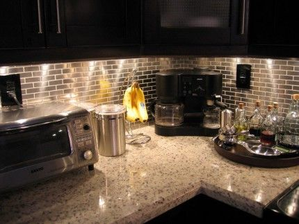 The stainless steel backsplash is really starting ti grow on me. Specifically the subway tile. *Love this