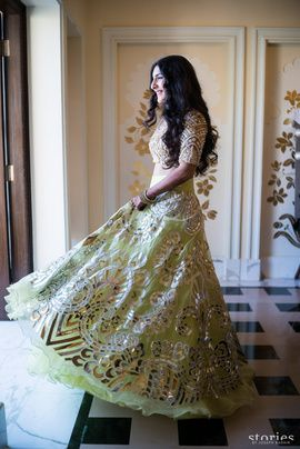 Sangeet Lehengas - Mint Green Lehenga with Metallic Work | WedMeGood Champagne Gold Lehenga with Silver Work and Mint Green Flared Lehenga with Metallic Gold Embedded Work. Designer Courtesy: @abusandeep #wedmegood #sangeet #lehengas #mint #green