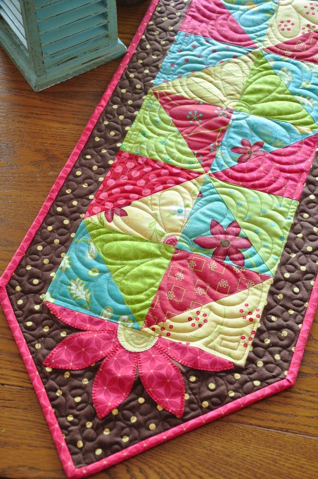 Use the half square method and skip the wildflowers - no tutorial, but in her book On the Run