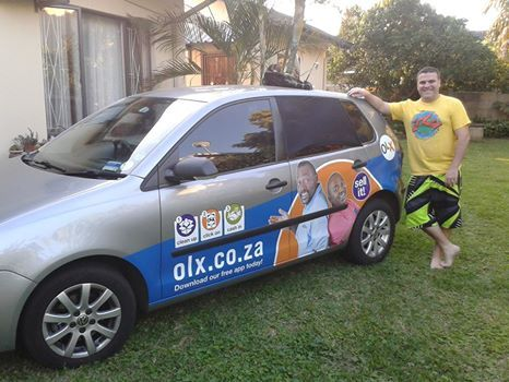 Russell taking his olx branded ride on holiday with him showing off the brand all
