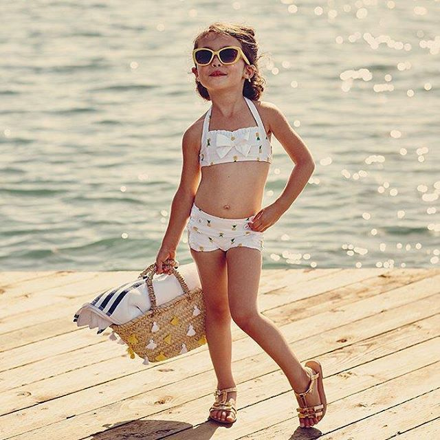 Darling for island time, our retro-inspired swimsuit features pineapple print and sweet ruffle trim. Shop link in bio.