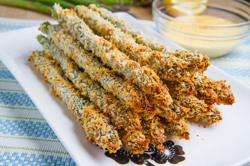CRISPY BAKED ASPARAGUS FRIES  --  1 pound asparagus, trimmed 1/2 cup flour 2 eggs, lightly beaten 3/4 cup panko breadcrumbs 1/4 cup parmigiano reggiano