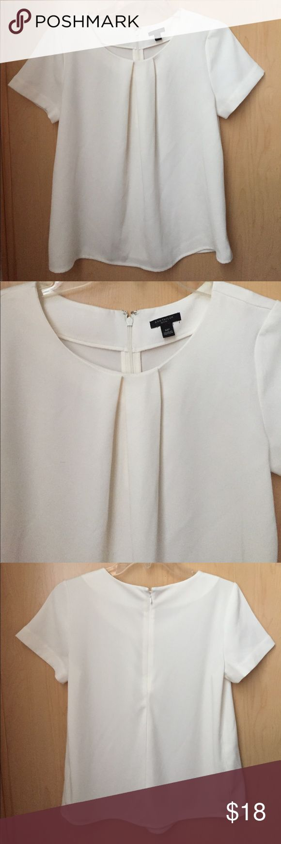 🆕 Ann Taylor Petite Blouse Cream petite blouse from Ann Taylor. One large accent pleat in front. Tiny exposed zipper in back. Has been worn but in great overall condition. Ann Taylor Tops Blouses