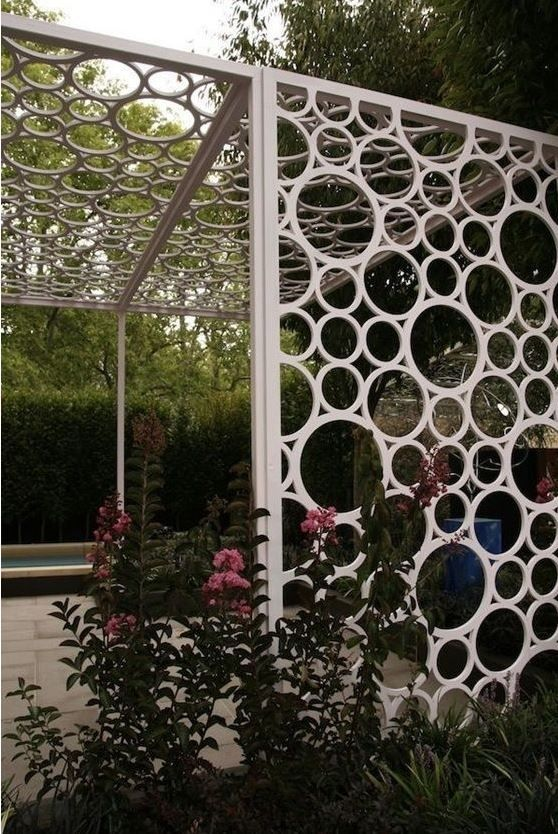 Cut different size PVC pipe - I could see as a room divider or even a picture collage