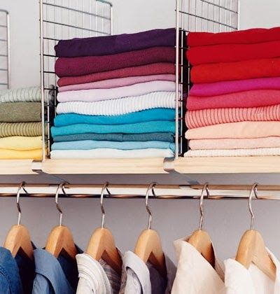 Using a divider on the shelf can help stack clothing so it doesn't fall over | OrganizingMadeFun.com